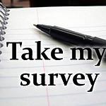 ノート帳面にTake my surveyと書かれている